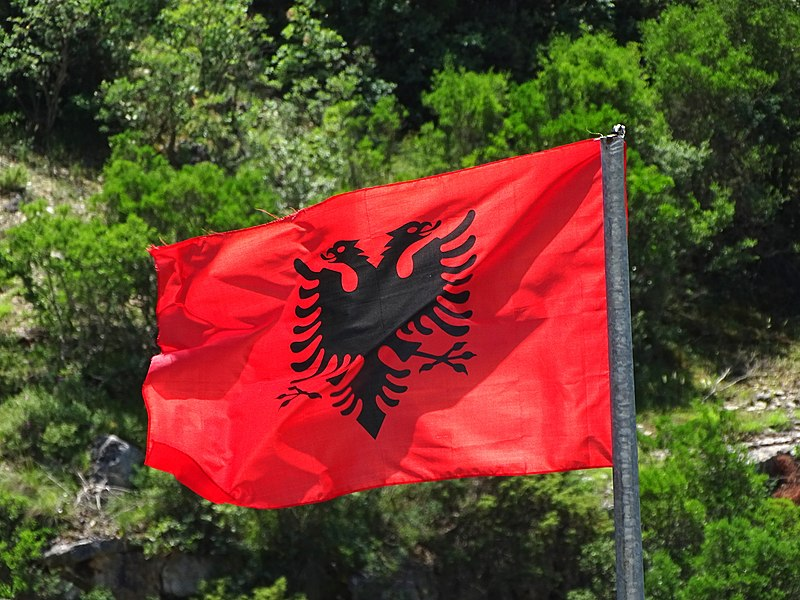 800px-Albanian_Flag_Flying_at_Osumi_Canyons_-_Outside_Corovoda_-_Albania_42538143721.jpg